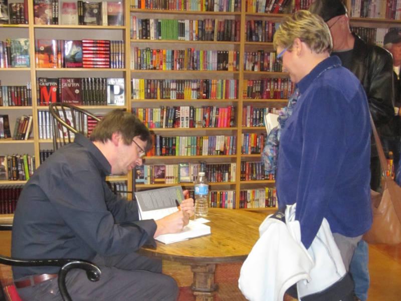 Ian Rankin signing a book