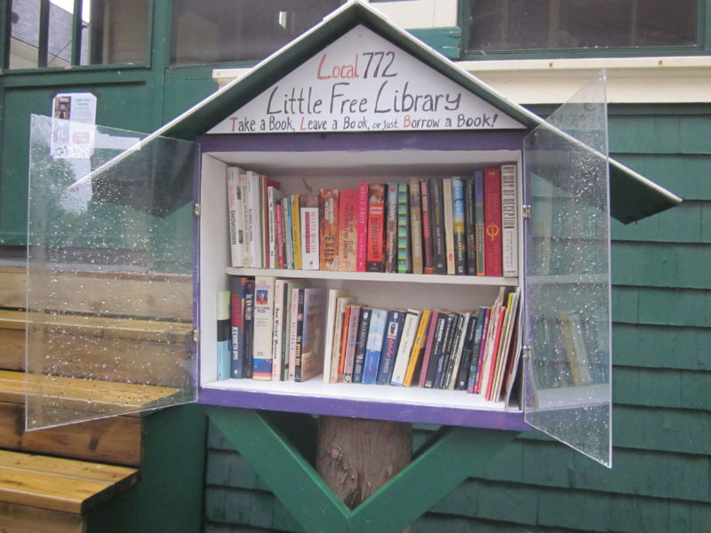 Open Little Free Library box containing two shelves filled with books
