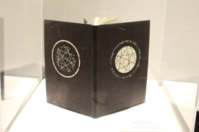 Brown book with astronomical design on it at Art of the Book