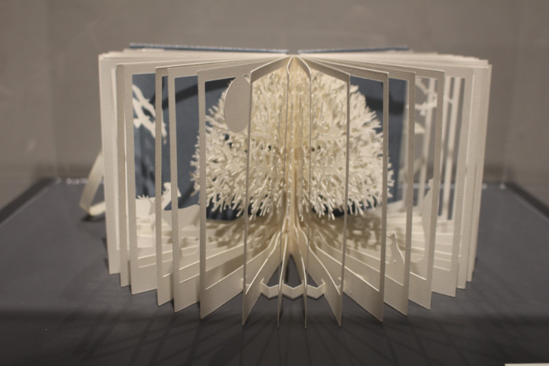Artist's book by Mary Conley with three-dimensional tree cut into it