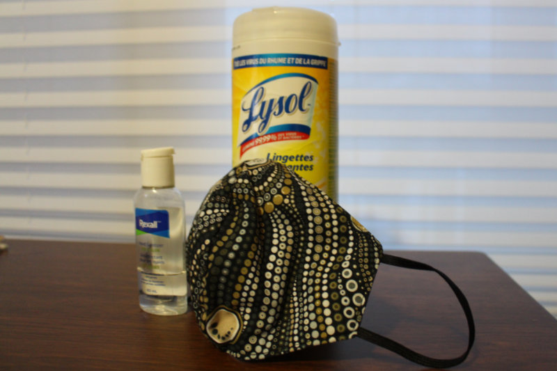 Sanitizing wipes, hand sanitizer, and a face mask - pandemic supplies